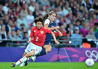 August 09, 2012: Japan's Yukari Kinga and United States' Alex Morgan in action during Women's Football Final match at the Wembley Stadium on day thirteen in Wembley, England. USA defeat Japan 2-1 to win it's third consecutive Olympic gold medal in women's soccer. ..