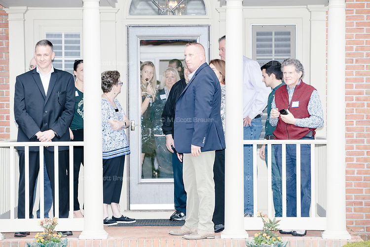 People await the arrival of Democratic presidential candidate and South Bend mayor Pete Buttigieg before he arrives to speak at a house party with the Bedford Democrats in Bedford, New Hampshire, on Sat., Apr. 20, 2019. The candidate stood on a chair throughout his speech.
