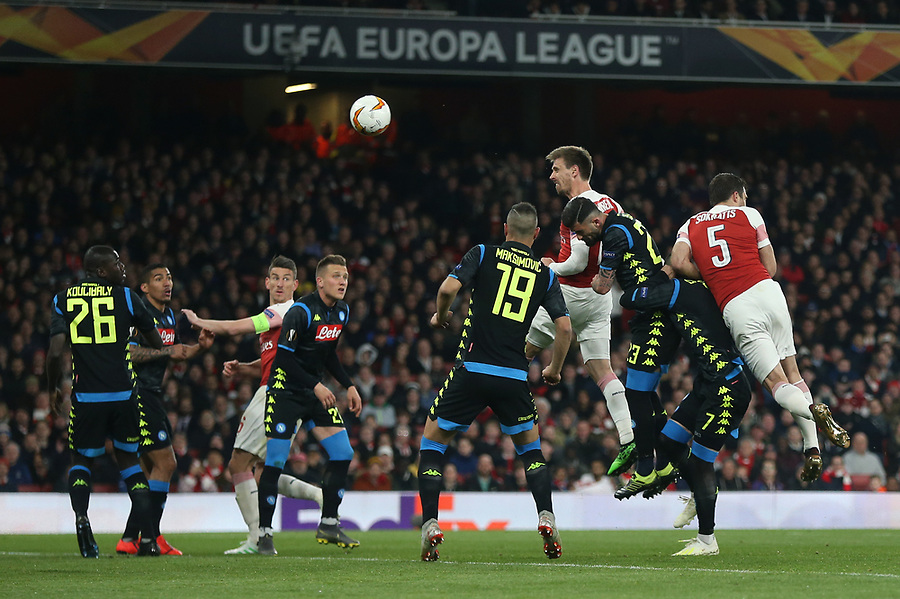 Arsenal's Nacho Monreal with a header towards goal<br /> <br /> Photographer Rob Newell/CameraSport<br /> <br /> UEFA Europa League First Leg - Arsenal v Napoli - Thursday 11th April 2019 - The Emirates - London<br />  <br /> World Copyright © 2018 CameraSport. All rights reserved. 43 Linden Ave. Countesthorpe. Leicester. England. LE8 5PG - Tel: +44 (0) 116 277 4147 - admin@camerasport.com - www.camerasport.com