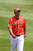 Wisconsin Timber Rattlers pitching coach Hiram Burgos (19) prior to a game against the Quad Cities River Bandits on July 11, 2021 at Neuroscience Group Field at Fox Cities Stadium in Grand Chute, Wisconsin.  (Brad Krause/Four Seam Images)