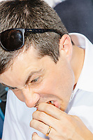 South Bend mayor and Democratic presidential candidate Pete Buttigieg eats deep-fried oreos at the Iowa State Fair in Des Moines, Iowa, on Tues., Aug. 13, 2019.