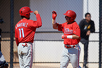 Philadelphia Phillies Josh Stephen (2) is congratulated by Nerluis Martinez (11) during a Minor League Spring Training game against the Pittsburgh Pirates on March 23, 2018 at the Carpenter Complex in Clearwater, Florida.  (Mike Janes/Four Seam Images)