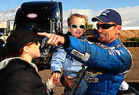 Feb. 22, 2010; Chandler, AZ, USA; NHRA funny car driver Jack Beckman (right) celebrates with son Jason Beckman and wife Jenna Beckman after winning the Arizona Nationals at Firebird International Raceway. The race is being run Monday after weather and darkness led to the cancellation of Sunday race action. Mandatory Credit: Mark J. Rebilas-
