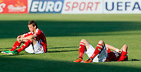 Patrick Olsen (R) and Lucas Andersen are dejected after the UEFA U-17 championship semi final match between Denmark and Germany on May 12, 2011 in Novi Sad, Serbia. (Photo by Srdjan Stevanovic/Starsportphoto.com)