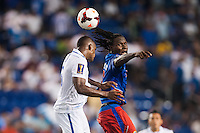 Haiti forward Leonel Saint Preux (18) watches as Honduras defender Brayan Beckeles (3) heads the ball. Honduras defeated Haiti 2-0 during a CONCACAF Gold Cup group B match at Red Bull Arena in Harrison, NJ, on July 8, 2013.