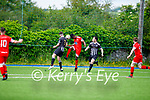 Heads up as Dynamos Asegad Wondermariam tries to head the ball goalboud as Alan Quirke of Strand Road puts his shoulder in the way of his effort as his team mate Tommy McCarthy keeps an eye of proceedings, in the Senior soccer league on Sunday