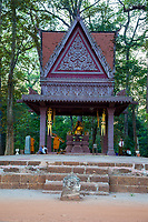 Cambodia, Bayon.  Modern Buddhist Shrine Facing the Bayon Temple.