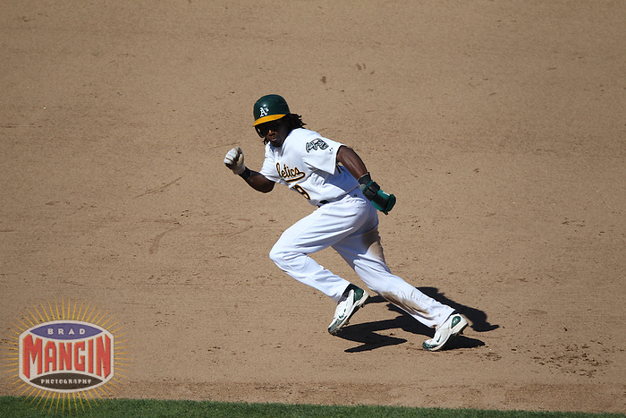 OAKLAND, CA - SEPTEMBER 22:  Jemile Weeks #19 of the Oakland Athletics runs the bases against the Texas Rangers during the game at O.co Coliseum on September 22, 2011 in Oakland, California. Photo by Brad Mangin