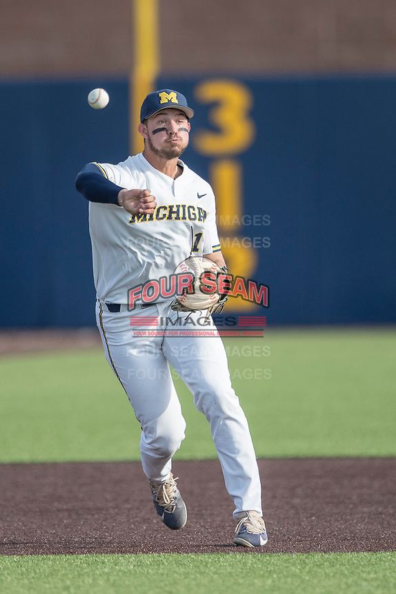 Michigan Wolverines third baseman Drew Lugbauer (17) makes a throw to first base during the NCAA baseball game against the Eastern Michigan Eagles on May 16, 2017 at Ray Fisher Stadium in Ann Arbor, Michigan. Michigan defeated Eastern Michigan 12-4. (Andrew Woolley/Four Seam Images)