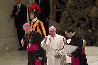 Papa Francesco benedice i fedeli al termine dell'udienza generale del mercoledi' in aula Paolo VI, Citta' del Vaticano, 13 gennaio 2016.<br /> Pope Francis delivers his blessing to faithful at the end of his weekly general audience in the Paul VI hall at the Vatican, 13 January 2016.<br /> UPDATE IMAGES PRESS/Riccardo De Luca<br /> <br /> STRICTLY ONLY FOR EDITORIAL USE
