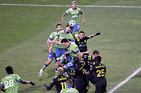 COLUMBUS, OH - DECEMBER 12: Gustav Svensson #4 of the Seattle Sounders FC rises above a crowd to head the ball during a game between Seattle Sounders FC and Columbus Crew at MAPFRE Stadium on December 12, 2020 in Columbus, Ohio.