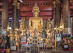 The main altar of Wat Mai Suwannaphumaham (or simply Wat Mai), a Buddhist temple and monastery located on the main street in Luang Prabang, Laos. The name of this temple also appears as Wat May Souvannapoumaram.