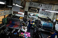 Colombian master printers prepare the ancient letterpress machines for a new load in the print shop in Cali, Colombia, 2 June 2012. Letterpress printing, invented by Johannes Gutenberg in the 15th century, remained the primary way to print and distribute information until the second half of the 20th century. The process of letterpress printing consists of composing movable types into the bed of a press, inking it, and pressing paper against it to create an impression. Nowadays, due to the offset printing expansion, there are few commercial print shops in the world keeping this traditional craftsmanship alive.
