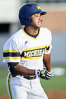Michigan Wolverines outfielder Johnny Slater (25) runs to first base against the Central Michigan Chippewas on March 29, 2016 at Ray Fisher Stadium in Ann Arbor, Michigan. Michigan defeated Central Michigan 9-7. (Andrew Woolley/Four Seam Images)