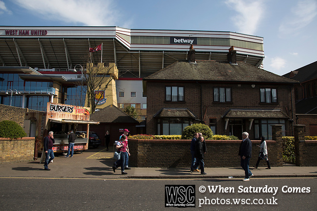 West Ham United 2 Crystal Palace 2, 02/04/2016. Boleyn Ground, Premier League. Fans walking along Green Street outside the Boleyn Ground before West Ham United hosted Crystal Palace in a Barclays Premier League match. The Boleyn Ground at Upton Park was the club's home ground from 1904 until the end of the 2015-16 season when they moved into the Olympic Stadium, built for the 2012 London games, at nearby Stratford. The match ended in a 2-2 draw, watched by a near-capacity crowd of 34,857. Photo by Colin McPherson.