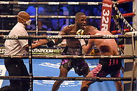 Ekow Essuman (black/purple shorts) defeats Chris Jenkins during a Boxing Show at the SSE Arena on 24th July 2021