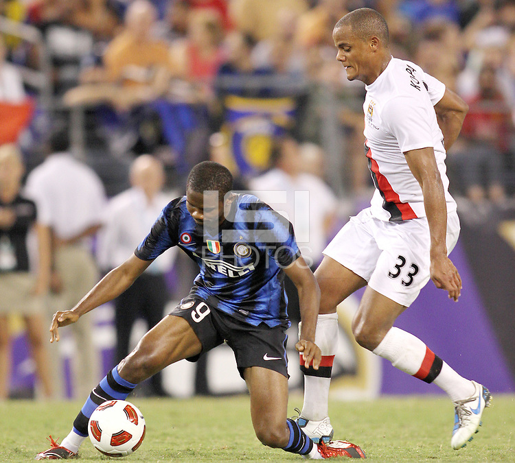 Samuel Eto'o #9 of Inter Milan is brought down by Vincent Kompany #33 of Manchester City during an international friendly match on July 31 2010 at M&T Bank Stadium in Baltimore, Maryland. Milan won 3-0.