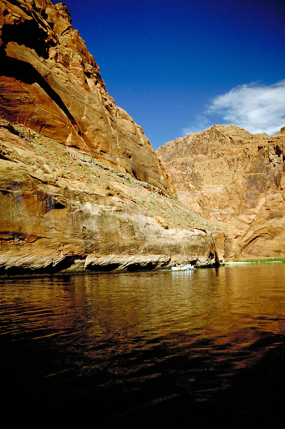 Smooth water rafting on the Colorado River through the canyon walls of Glen Canyon in northern Arizona. landscape, rock formations, geology, waterways. Glen Canyon, Arizona. Arizona, Glen Canyon.