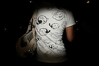 CHINA. Beijing. The back of a woman's shirt near the Olympic village during the Beijing 2008 Summer Olympics. 2008