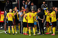 Watford caretaker manager Hayden Mullins gives a team talk during the first drinks break during the Premier League match between Watford and Manchester City at Vicarage Road, Watford, England on 21 July 2020. Football Stadiums around remain empty due to the Covid-19 Pandemic as Government social distancing laws prohibit supporters inside venues resulting in all fixtures being played behind closed doors until further notice.<br /> Photo by Andy Rowland.