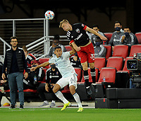 WASHINGTON, DC - MAY 13: Julian Gressel #31 of D.C. United heads the ball against Miguel Angel Navarro #6 of Chicago Fire during a game between Chicago Fire FC and D.C. United at Audi FIeld on May 13, 2021 in Washington, DC.