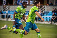 SAN JOSE, CA - MAY 12: Nouhou Tolo #5 of the Seattle Sounders celebrates the goal of Cristian Roldan #7 of the Seattle Sounders during a game between San Jose Earthquakes and Seattle Sounders FC at PayPal Park on May 12, 2021 in San Jose, California.