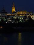 A night view across the Gaudalquivir in Seville, Spain.