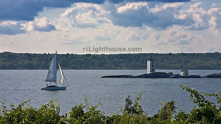 Sailors keep their distance as they pass the rocks at Dutch Island Lighthouse.