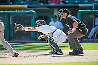 Charlie Cutler (37) of the Salt Lake Bees on defense with home plate umpire Ryan Goodman  against the Reno Aces in Pacific Coast League action at Smith's Ballpark on May 10, 2015 in Salt Lake City, Utah. Reno defeated Salt Lake 11-2 in Game Two of the double-header.  (Stephen Smith/Four Seam Images)