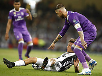 Calcio, Champions League: finale Juventus vs Real Madrid. Cardiff, Millennium Stadium, 3 giugno 2017.<br /> Juventus' Paulo Dybala (l) in action with Real Madrid's Segio Ramos during the Champions League final match between Juventus and Real Madrid at Cardiff's Millennium Stadium, Wales, June 3, 2017. Real Madrid won 4-1.<br /> UPDATE IMAGES PRESS/Isabella Bonotto