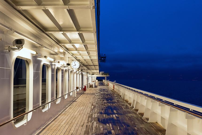 Cruise ship deck at dusk.