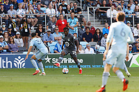 ST. PAUL, MN - AUGUST 21: Justin McMaster #24 of Minnesota United FC with the ball during a game between Sporting Kansas City and Minnesota United FC at Allianz Field on August 21, 2021 in St. Paul, Minnesota.