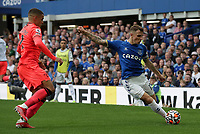 25th September 2021; Goodison Park, Liverpool, England; Premier League football, Everton versus Norwich; Lucas Digne of Everton crosses the ball under pressure from Max Aarons of Norwich City