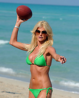 """MIAMI BEACH, FL-MARCH 19:  (EXCLUSIVE COVERAGE) Victoria Silvstedt cares about the environment as she  goes """"ALL GREEN"""" in a sexy Bikini on Miami Beach. She enjoyed a day with her friends , playing football,tennis and tanning,  at one point she even grabbed a super soaker water gun and started sraying her friends on the beach.  on March 19, 2009 in Miami Beach, Florida<br /> <br /> <br /> People:  Victoria Silvstedt"""