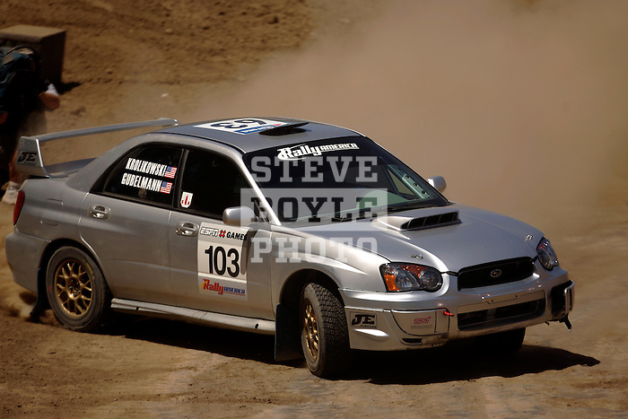 A rally car comes around a turn near the finish line while competing in the Rally Car Race finals during X-Games 12 in Los Angeles, California on August 5, 2006.