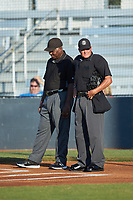 Umpires Chauncey Bowers (left) and Britton Kennerly stand at home plate prior to the Southern Collegiate Baseball League game between the Concord A's and the Mooresville Spinners at Moor Park on July 31, 2020 in Mooresville, NC. The Spinners defeated the Athletics 6-3 in a game called after 6 innings due to rain. (Brian Westerholt/Four Seam Images)