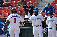 Buffalo Bisons second baseman Bobby Scales #10 greets Jordany Valdespin #1 after hitting a home run during a game against the Lehigh Valley IronPigs at Coca-Cola Field on April 19, 2012 in Buffalo, New York.  Lehigh Valley defeated Buffalo 8-4.  (Mike Janes/Four Seam Images)