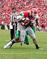 The Georgia Bulldogs played North Texas Mean Green at Sanford Stadium.  After North Texas tied the game at 21 early in the second half, the Georgia Bulldogs went on to score 24 unanswered points to win 45-21.  Georgia Bulldogs tight end Arthur Lynch (88) struggles to the goal line with North Texas Mean Green defensive back Hilbert Jackson (6) hanging on.