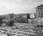 Pittsburgh PA:  View of the point area prior to the Gateway Center construction.  Eppy's parking lot at Liberty Avenue and Third Avenue in Pittsburgh.  Horne's Department Store in the Background. Company signs on the city buildings include Robert L Brahm Company, Clark Candy Sign, Commonwealth Heating Company,