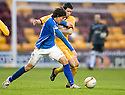 ST JOHNSTONE'S DAVID MCCRACKEN TRIES TO GET AWAY FROM MOTHERWELL'S TIM CLANCY