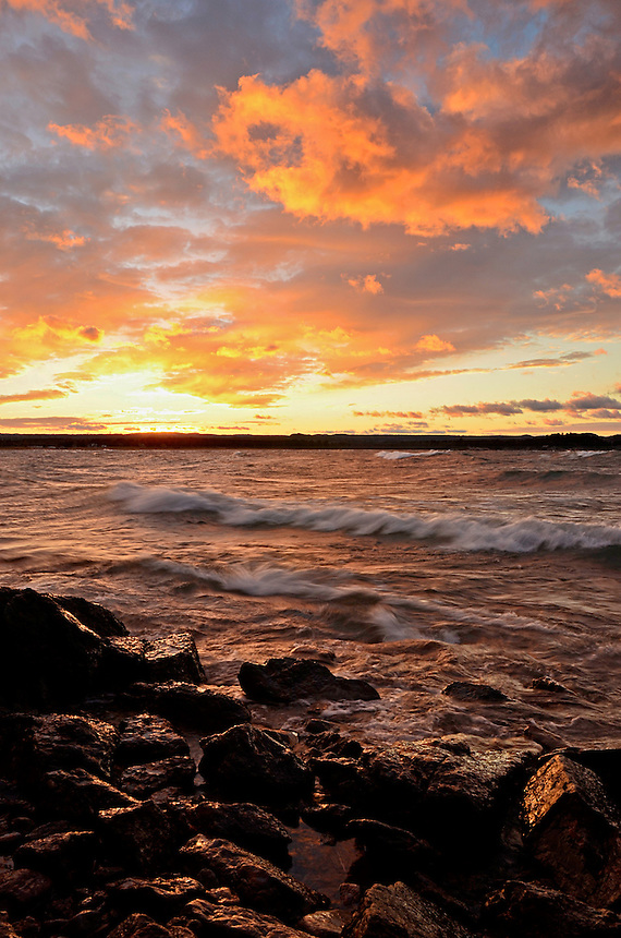 A golden orange sunset over Lake Superior on the first day of November 2012. Presque Isle Park, Marquette, MI