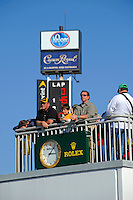 Fans on the skydeck before the start. Thescoring pylon displays the #45 Flying Lizard Porsche/Riley on the pole.
