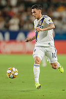 CARSON, CA - SEPTEMBER 15: Cristian Pavon #10 of the Los Angeles Galaxy moves with the ball during a game between Sporting Kansas City and Los Angeles Galaxy at Dignity Health Sports Complex on September 15, 2019 in Carson, California.