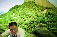 China. Shanghai. World Expo. Expo 2010 Shanghai China.  China Pavilion. A private guard seats at the entrance of the the Fujian pavilion. 25.06.10 © 2010 Didier Ruef