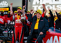 Oct 4, 2020; Madison, Illinois, USA; NHRA top fuel driver Doug Kalitta (left) and team owner Connie Kalitta celebrates after winning the Midwest Nationals at World Wide Technology Raceway. Mandatory Credit: Mark J. Rebilas-USA TODAY Sports
