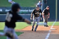 Shortstop Derek Hirsch (11) of the Wofford Terriers takes a lead off third in a SoCon Tournament game against Western Carolina on Wednesday, May 25, 2016, at Fluor Field at the West End in Greenville, South Carolina. Western won, 10-9. (Tom Priddy/Four Seam Images)