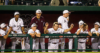 Members of the Missouri State Bears stand in the dugout just before the game winning hit during a game against the Kansas Jayhawks at Hammons Field on March 27, 2012 in Springfield, Missouri. (David Welker/Four Seam Images)