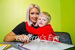 Mags Sugrue at home in Tralee with her son Lucas who is a pupil in CBS Primary Tralee, doing his on line classes