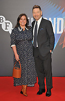 """Lindsay Brunnock and Kenneth Branagh at the 65th BFI London Film Festival """"Belfast"""" American Airlines gala, Royal Festival Hall, Belvedere Road, on Tuesday 12th October 2021, in London, England, UK."""