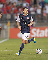 USMNT defender Michael Parkhurst (15) looks to pass. In CONCACAF Gold Cup Group Stage, the U.S. Men's National Team (USMNT) (blue/white) defeated Costa Rica (red/blue), 1-0, at Rentschler Field, East Hartford, CT on July 16, 2013.